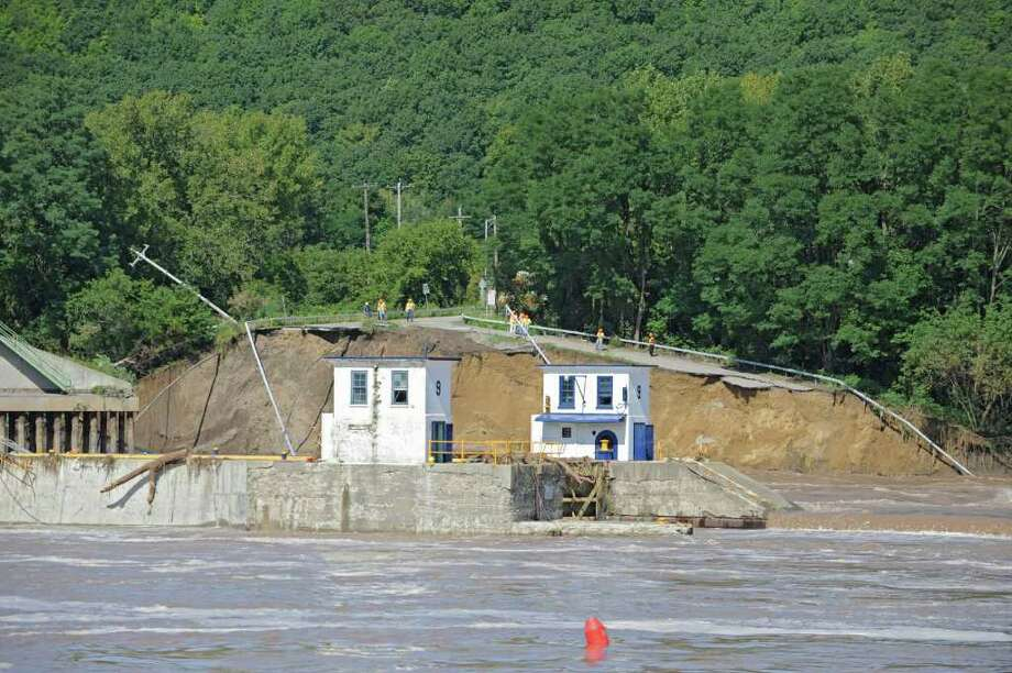 Part of the bridge and land at Lock 9 on Bridge Street in Rotterdam Junction , N.Y., has washed away from the Mohawk River flooding on Sept. 9, 2011. (Lori Van Buren / Times Union) Photo: Lori Van Buren