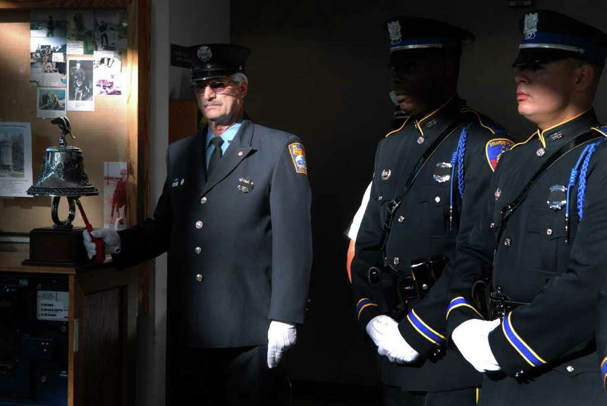Retired firefighter Bob Ofiero rings the Last Alarm Bell at a ceremony at the Government Center in Stamford, Conn on Friday September 9, 2011 to commemorate the 10th anniversary of September 11, 2001 and to dedicate a new memorial created from a piece of steel from the Twin Towers.