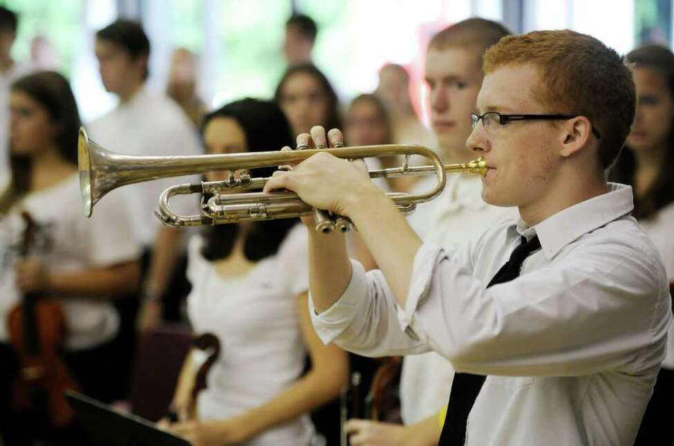 A member of the High School band plays Taps at the 9/11 remembrance assembly at the Ballston Spa High School in Ballston Spa, N.Y., on Sept. 9, 2011. (Skip Dickstein/Times Union)
