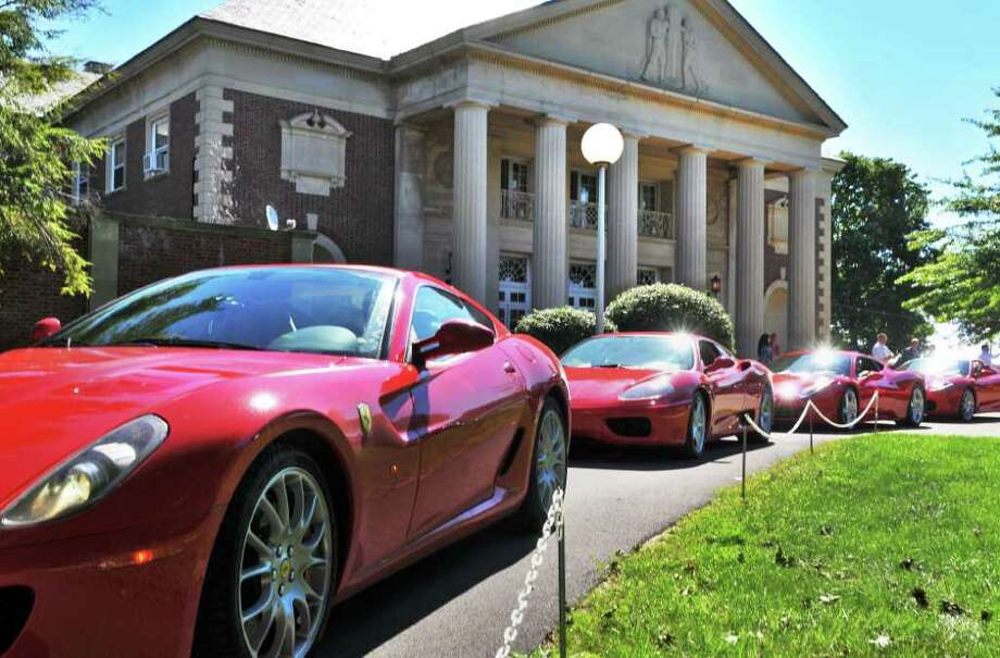 Ferraris parade by the Hall of Springs to kick off the 11th Annual Saratoga Wine & Food and Fall Ferrari Festival at  SPAC on Friday, Sept. 9, 2011. (John Carl D'Annibale / Times Union) Photo: John Carl D'Annibale / 00014564A