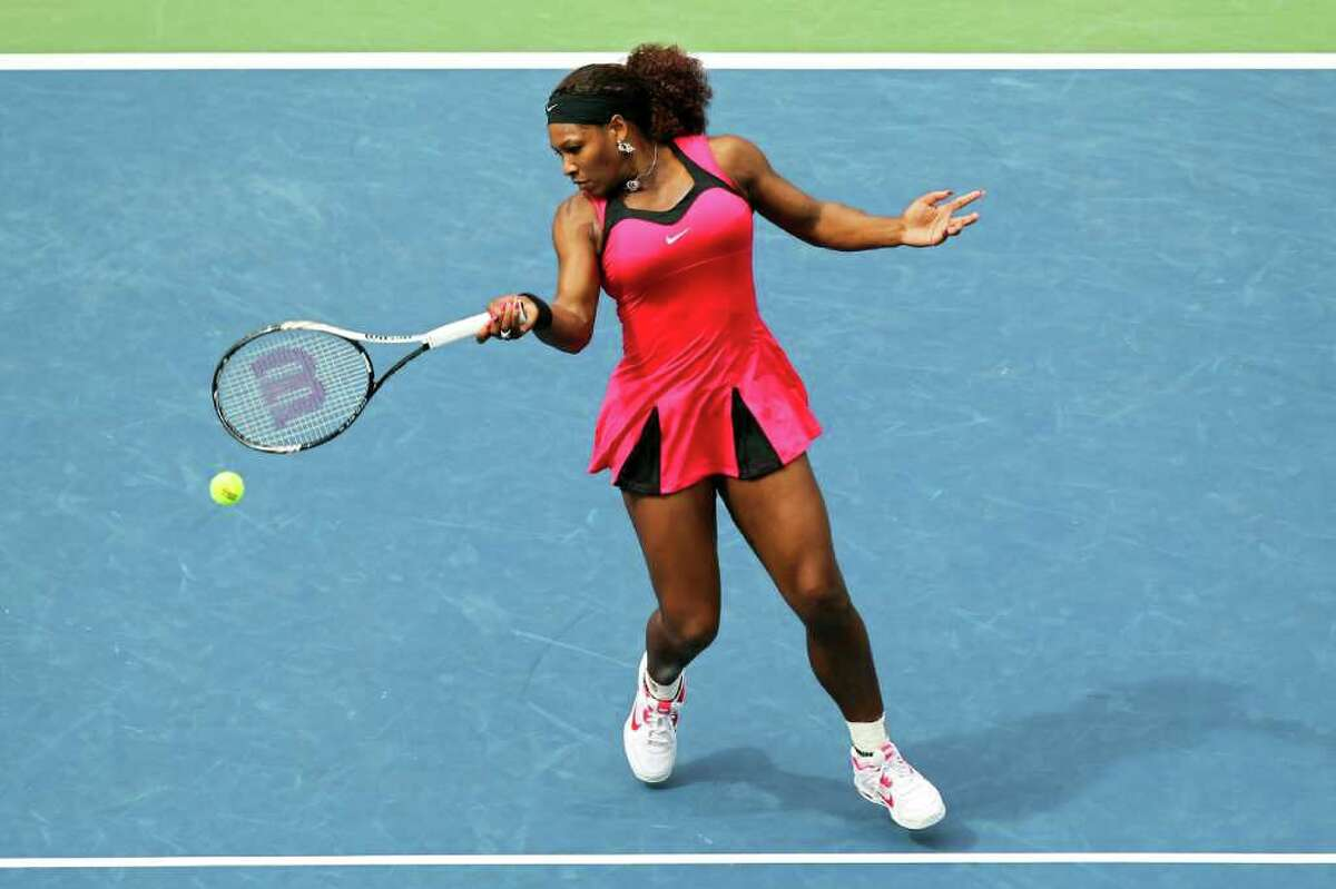 Serena Williams also toned down her usual sartorial fanfare, and looked better than ever in a hot pink minidress. The bold hue was one of the most popular colors for women at this year's tournament.