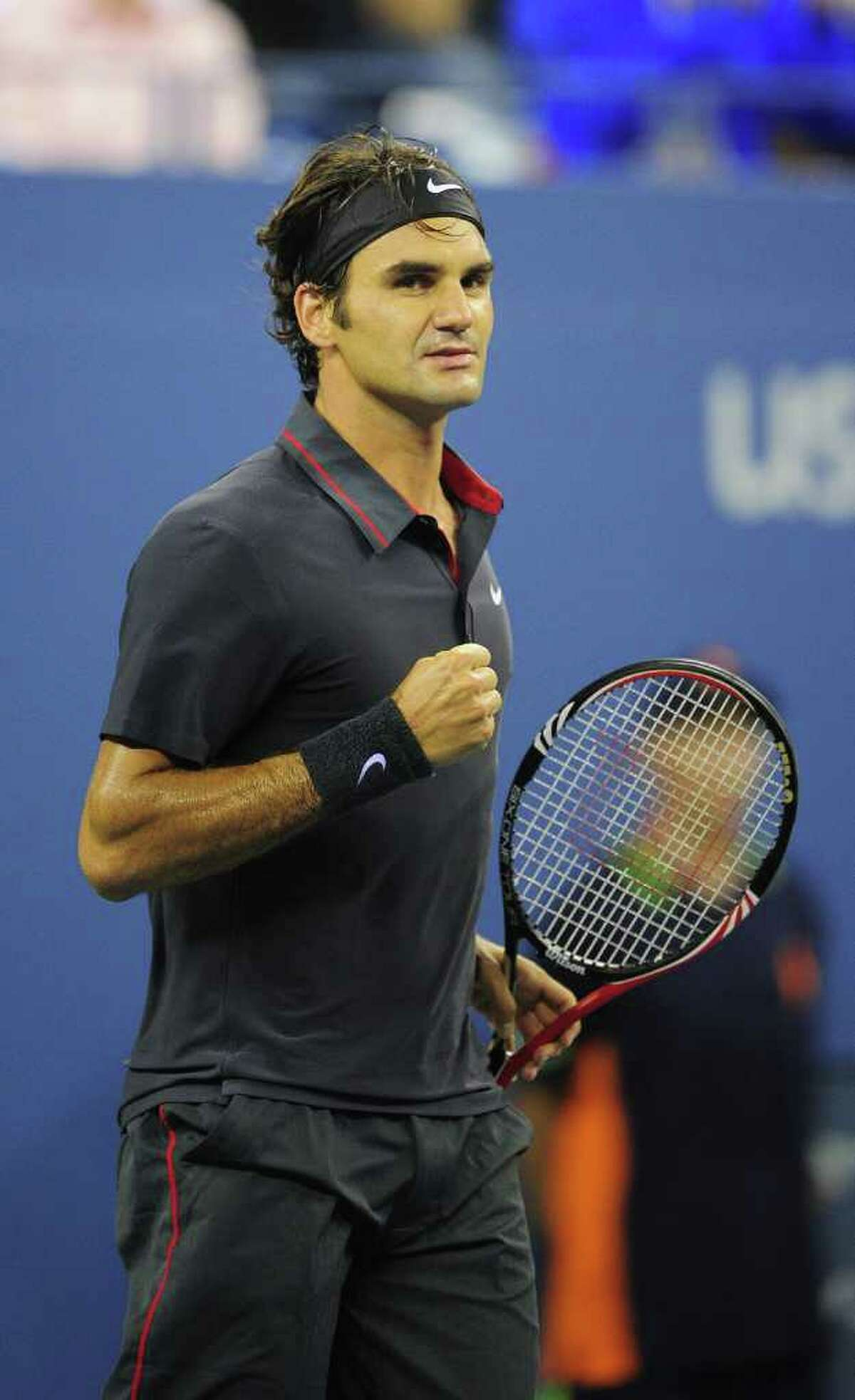 Roger Federer looked classic as always in a monochromatic ensemble.