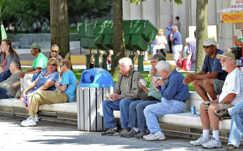 Onlookers sit in the shade and listening to music during Local Legends Live at the Empire State Plaza in Albany on Friday, Sept. 9, 2011.   (John Carl D'Annibale / Times Union) Photo: John Carl D'Annibale