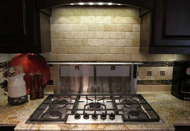 A stainless gas range graces a counter top in home number one at the 2011 Parade of Homes in the Champions Ridge subdivision. The home is by Adam Wilson Custom Homes. (Sunday September 4, 2011) JOHN DAVENPORT/jdavenport@express-news.net Photo: SAN ANTONIO EXPRESS-NEWS