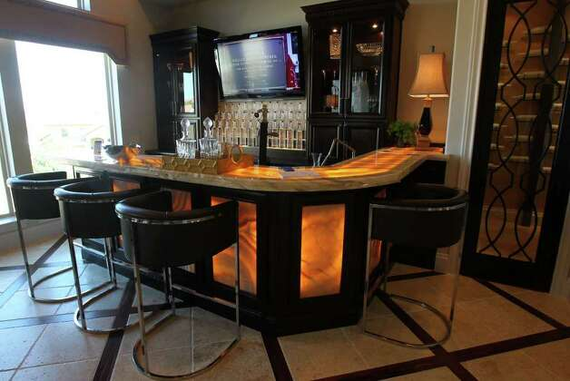 This is the bar area in home number two on the 2011 Parade of Homes in Champions Ridge subdivision. Home number two is by the Sitterle Homes Luxury Collection and is located at 110 Champions View. (Sunday September 4, 2011)  JOHN DAVENPORT/jdavenport@express-news.net Photo: SAN ANTONIO EXPRESS-NEWS
