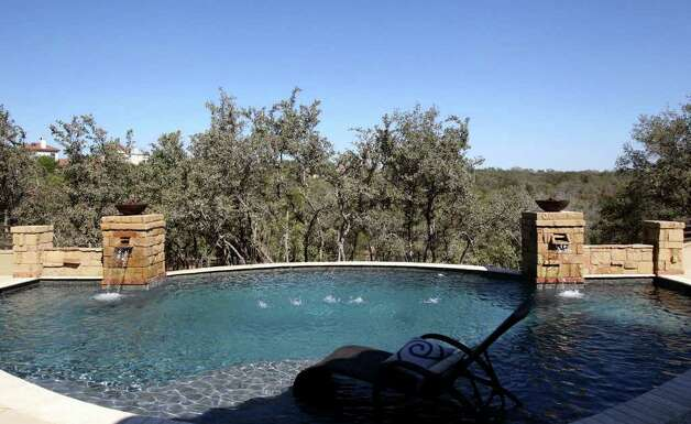 This is the swimming pool at home number three at the 2011 Parade of Homes in the Champions Ridge subdivision in Stone Oak. The home is by Burdick & Frank, Ltd. and has a spa in the master bath. JOHN DAVENPORT/jdavenport@express-news.net Photo: SAN ANTONIO EXPRESS-NEWS