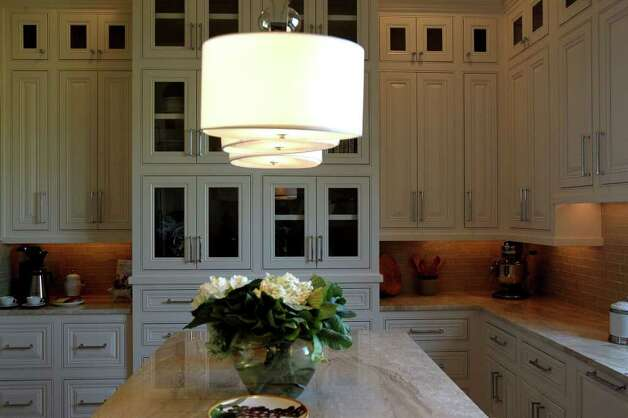 The auxillary kitchen in home number six at the 2011 Parade of Homes has intricate cabinate detail. The home is by Greenwood Custom Homes. (Sunday September 4, 2011) JOHN DAVENPORT/jdavenport@express-news.net Photo: SAN ANTONIO EXPRESS-NEWS