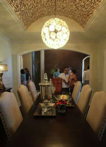 This is the formal dining area in home number one of the 2011 Parade of Homes in the Champions Ridge subdivision in the Stone Oak area. The home is by Adam Wilson Custom Homes. (Sunday September 4, 2011) JOHN DAVENPORT/jdavenport@express-news.net Photo: SAN ANTONIO EXPRESS-NEWS