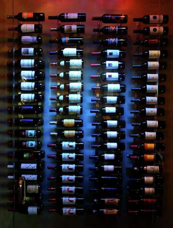 Wine bottles are displayed in home number four by Mike Hollaway Custom Homes at the 2011 Parade of Homes in the Champions Ridge subdivision in Stone Oak. (Sunday September 4, 2011) JOHN DAVENPORT/jdavenport@express-news.net Photo: SAN ANTONIO EXPRESS-NEWS