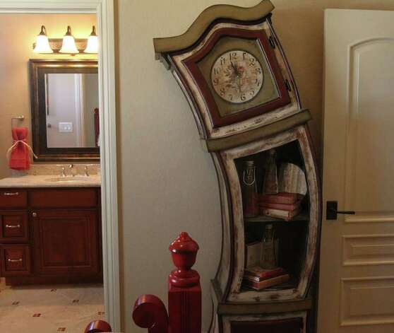 A wacky shaped grandfather clock accents a child's room in home number five at the Parade of Homes in the Champions Ridge area in Stone Oak. Home number five is by Dale Sauer Homes. (Sunday September 4, 2011) JOHN DAVENPORT/jdavenport@express-news.net Photo: SAN ANTONIO EXPRESS-NEWS