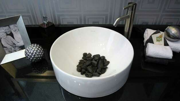 A custom sink in one of the bathrooms at home number four has rocks in it at the  2011 Parade of Homes in the Champions Ridge subdivision in Stone Oak. The home is by Mike Hollaway Custom Homes. (Sunday September 4, 2011) JOHN DAVENPORT/jdavenport@express-news.net Photo: SAN ANTONIO EXPRESS-NEWS