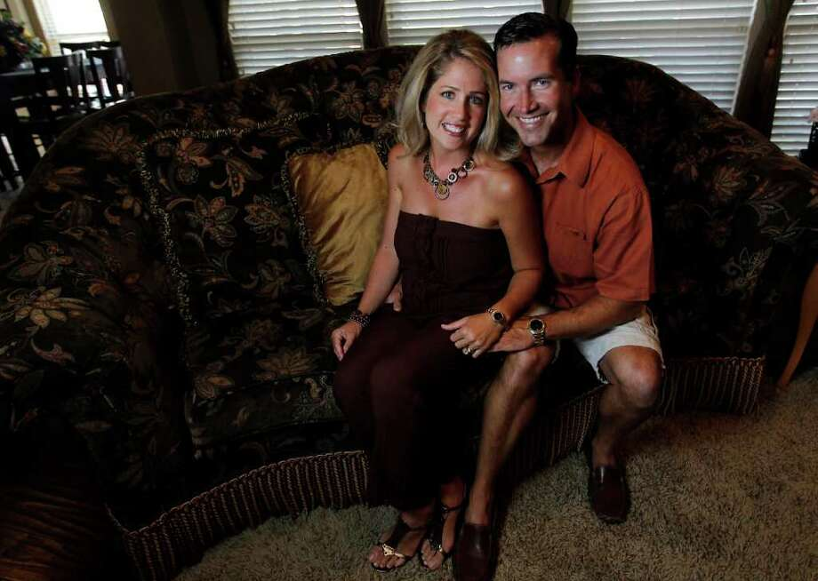 KAREN WARREN : STAFF WORKING TOGETHER: Joy and Landon Blair  have been married 17 years. They met in Clear Lake when she was in seventh grade and he was in eighth grade. Photo: Karen Warren / © 2011 Houston Chronicle