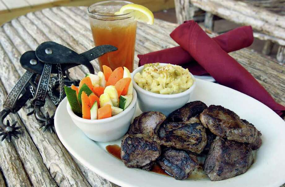 The KC Style Tenderloin comes in portions ranging from the 10-ounce KC Lite to 56 ounces for four people. Photo: TOM REEL, SAN ANTONIO EXPRESS-NEWS / © 2011 San Antonio Express-News