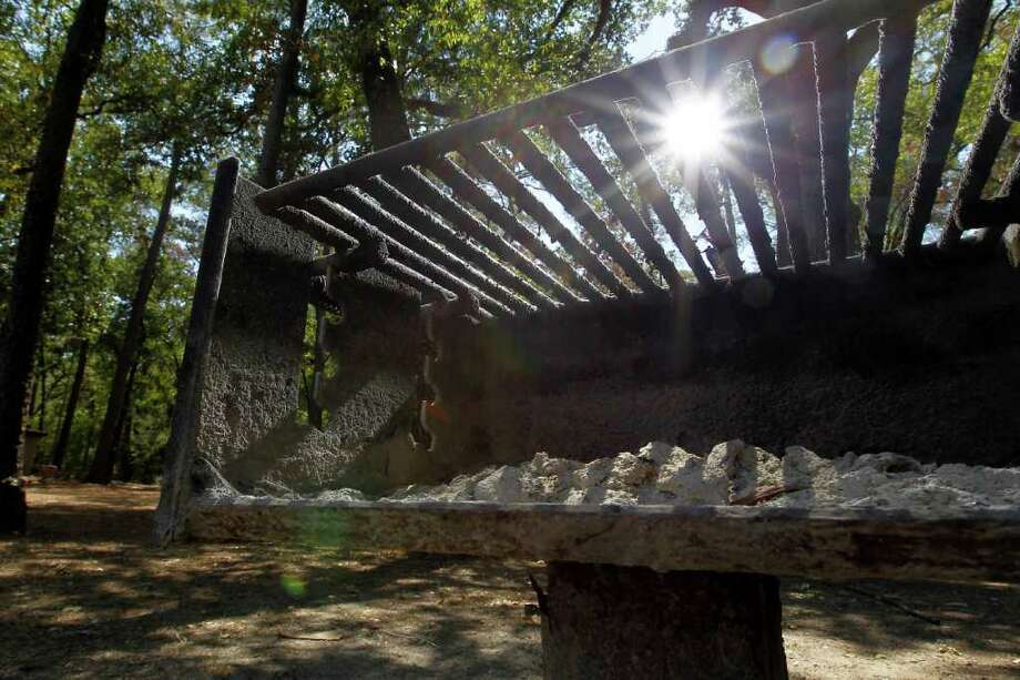You can't use this grill in the picnic area at Memorial Park. A temporary ban on grilling in Houston's parks is in effect. Photo: Karen Warren / © 2011 Houston Chronicle
