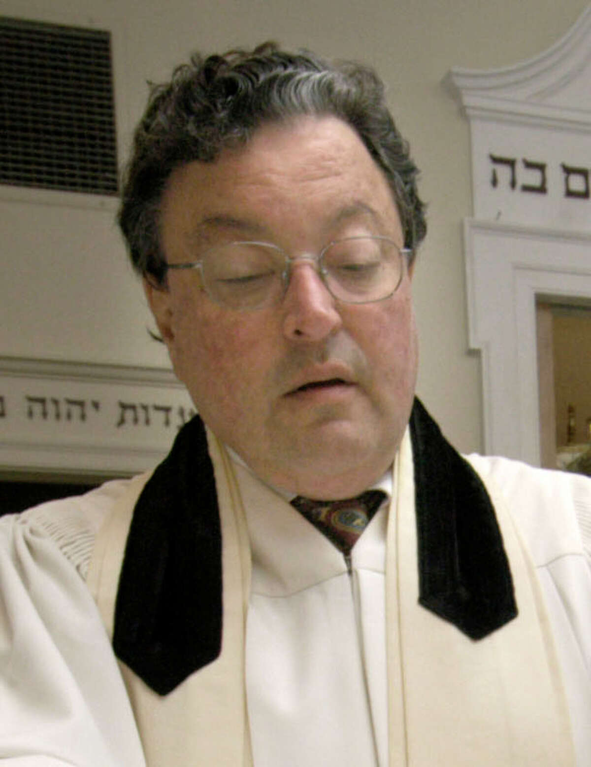 Rabbi Clifford Librach of the United Jewish Center in Danbury reads from the Torah in this News-Times file photo.