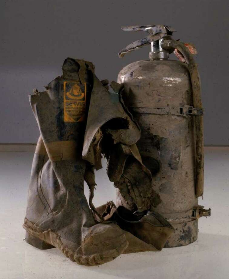PHILIP KAMRASS :  ALBANY TIMES UNION MEMORIES: A boot and fire extinguisher, found in the ruins of the World Trade Center site in New York City, are among items in the New York State Museum in Albany. Photo: PHILIP KAMRASS / ALBANY TIMES UNION