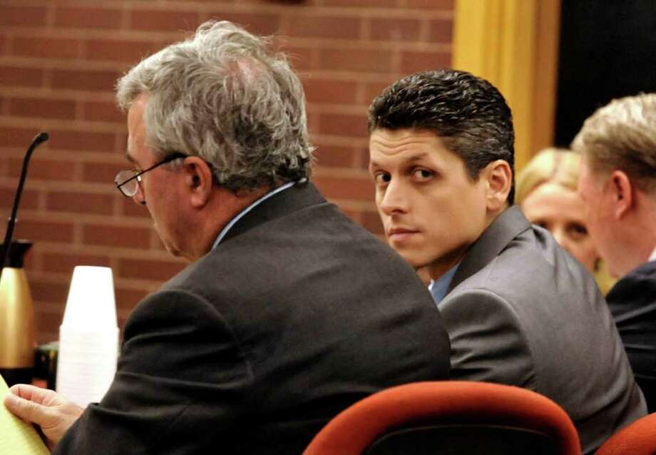 Jury selection for the witness tampering case for convicted killer Marash Gojcaj was pushed back to Oct. 26. Gojcaj is seen with his attorney last year during his murder trial. Photo: Michael Duffy/File Photo, ST / The News-Times