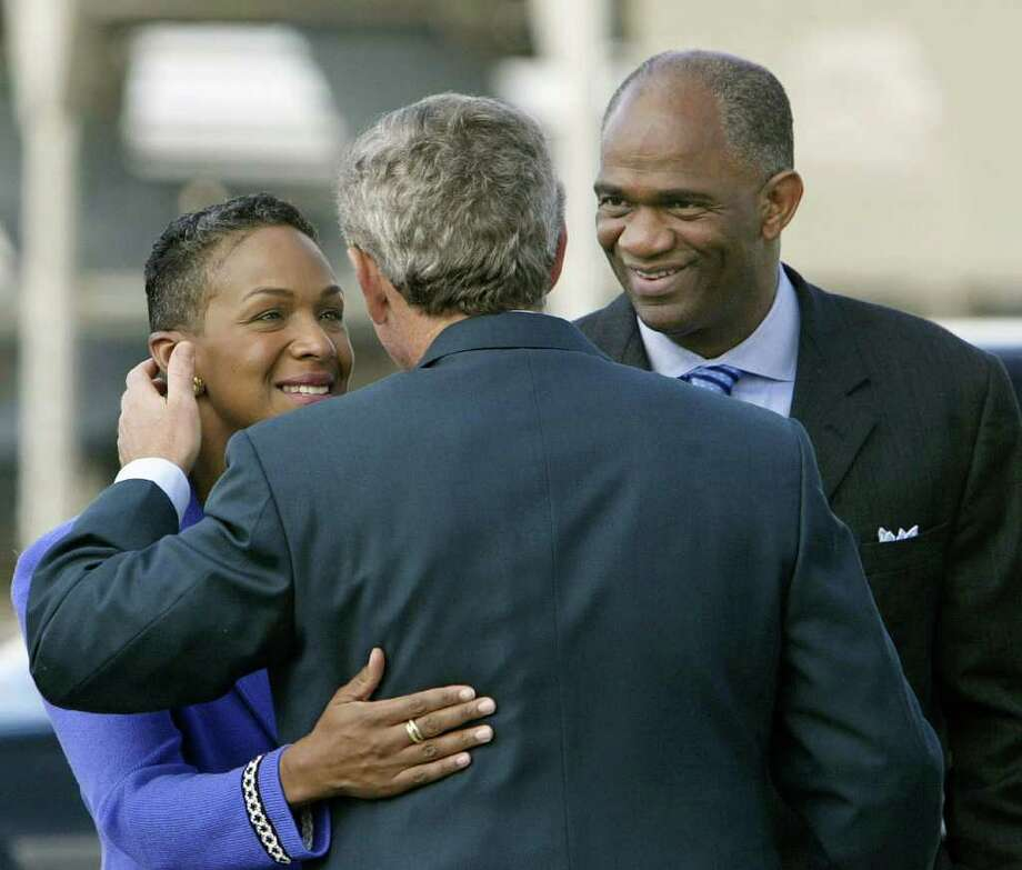 The Rev. Kirbyjon Caldwell and his wife, Suzette, are seen greeting George W. Bush at Ellington Field in 2003. Caldwell accompanied Bush as the president toured the wreckage days after 9/11 in 2001. Photo: J. SCOTT APPLEWHITE / AP