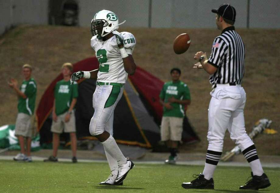 Brenham's Justin Davis flips the ball back to an official after intercepting Lamar's Darrell Colbert during the first half of their game, Friday at Delmar Stadium. Photo: Eric Christian Smith, For The Chronicle