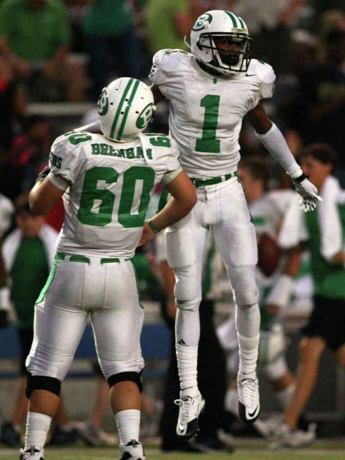 Brenham's Tre'mund Moore, right, celebrates a reception with teammate Ty Jahns during the first half. Photo: Eric Christian Smith, For The Chronicle