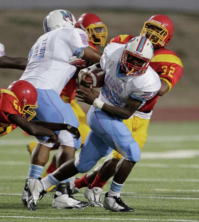Madison's Elijah Royal #23 breaks loose for a run in the second quarter during  a high school football game between Madison and Yates at Barnett Stadium on Friday September 9, 2011. Photo: Bob Levey, Houston Chronicle / ©2011 Bob Levey