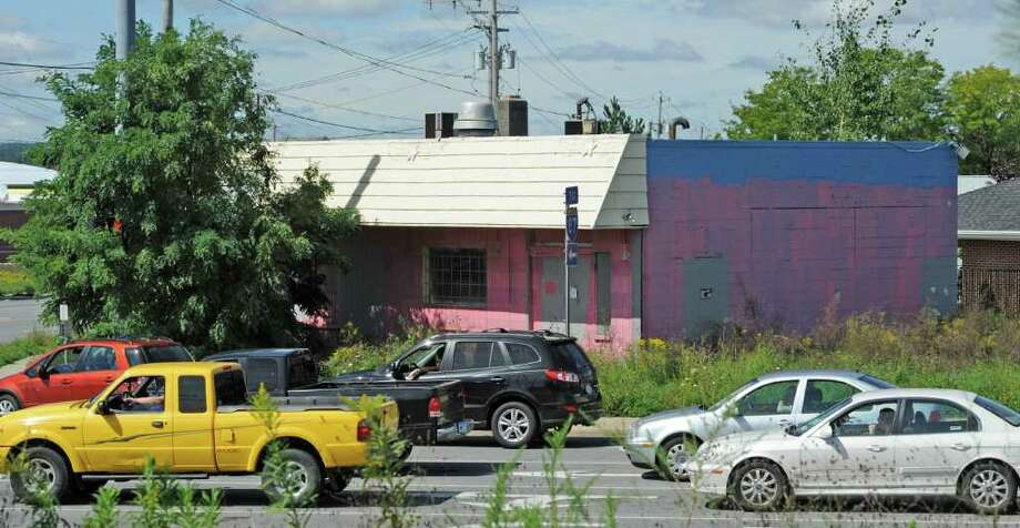 Sebastians, the building with the pink paint job and the center of much controversy still sits on the corner or Route 7 near the professional building in Latham, N.Y. September 9, 2011.  (Skip Dickstein/Times Union) Photo: Michael Townsend / 00014582A