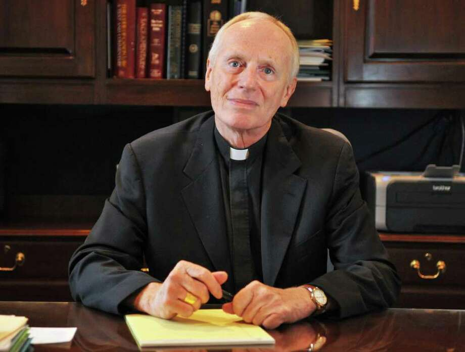 Howard J. Hubbard, Bishop of Albany at his desk at the Pastoral Center in Albany Tuesday Sept. 6, 2011.   (John Carl D'Annibale / Times Union) Photo: John Carl D'Annibale / 00014500A
