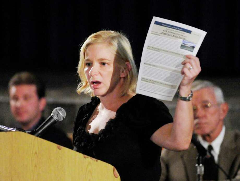 Sharee Rusnak of the state Department of Public Health holds up a health information sheet regarding contaminants during an open house held at Greenwich High School Sept. 7, 2011, by school officials to provide an overview of the ongoing soil contamination situation at the school. Photo: Bob Luckey, File Photo / Greenwich Time