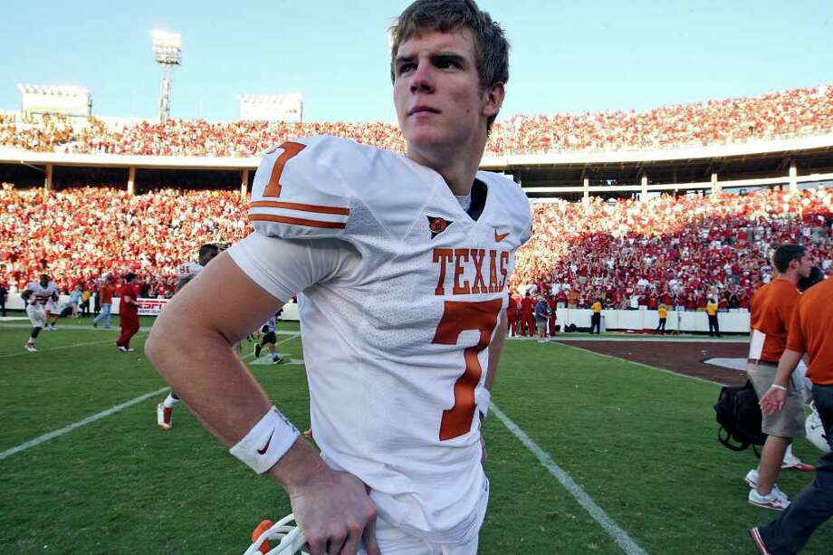 FOR SPORTS - Texas Longhorns'  Garrett Gilbert walks off the field Saturday Oct. 2, 2010 after the Red River Rivalry against the Oklahoma Sooners at the Cotton Bowl in Dallas, Tx. The Oklahoma Sooners won 28-20. (PHOTO BY EDWARD A. ORNELAS/eaornelas@express-news.net) Photo: EDWARD A. ORNELAS / San Antonio Express-News