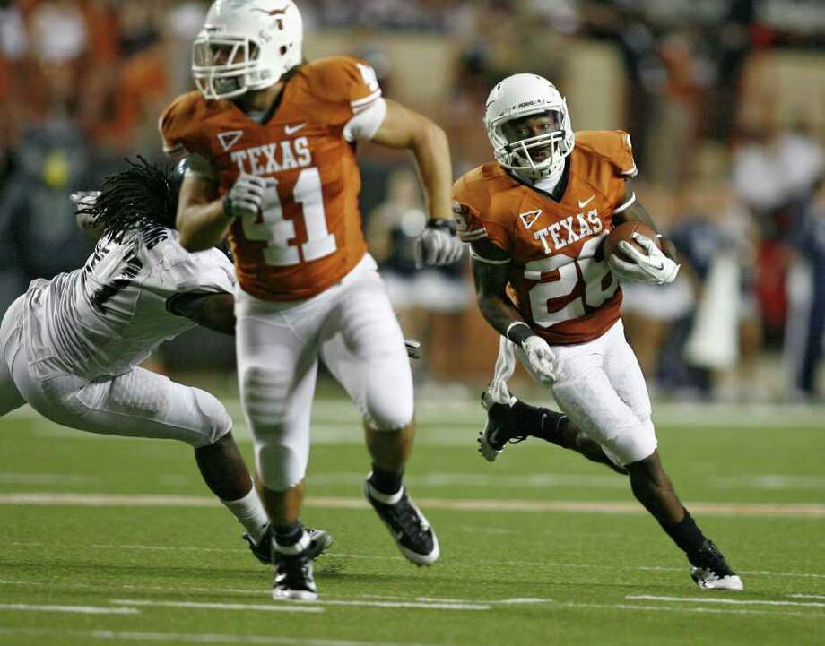 UT's fourth-string running back D.J. Monroe, right, rambled against Rice. Photo: Erich Schlegel / 2011 Getty Images