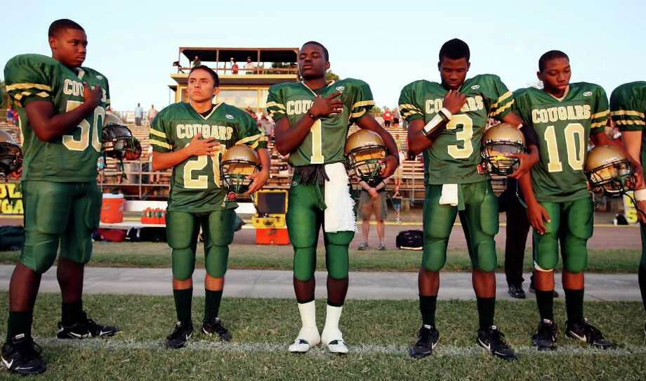 Cole's Terrance Hodges (from left), Moses Villescas, Bryce King, Tyreese Davis and D.J. Andrews pause during a moment of silence to remember the events of 9/11 before the game with Marion Friday Sept. 9, 2011 at Cole Stadium on Fort Sam Houston. Photo: EDWARD A. ORNELAS, Express-News / SAN ANTONIO EXPRESS-NEWS (NFS)