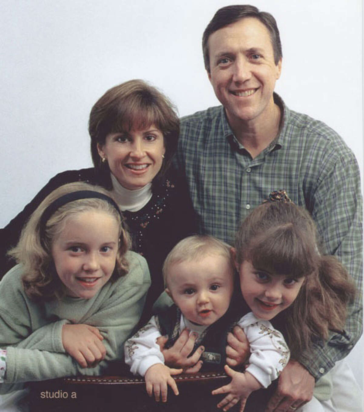 A portrait of the Lenihan family of Cos Cob in 2000. Front row, from left, siblings Megan, Joseph and Gabriele; top row from left, mother Ingrid and father Joseph, who was killed in the 9/11 attacks.