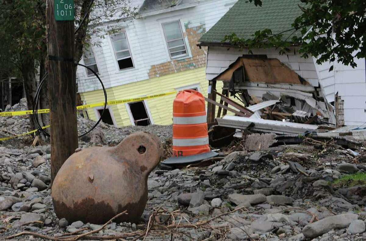 A wrecking ball was dropped off near damaged buildings on Main St. in Prattsville, N.Y. on Sept. 8, 2011. The Schoharie Creek flooded the town after tropical storm Irene.(Lori Van Buren / Times Union)