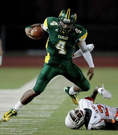 CODY DUTY: CHRONICLE OVER AND OUT: Klein Forest QB Matt Davis (4) is driven out of bounds by La Porte's Ellis Hutchinson on Friday night. Photo: Cody Duty / © 2011 Houston Chronicle