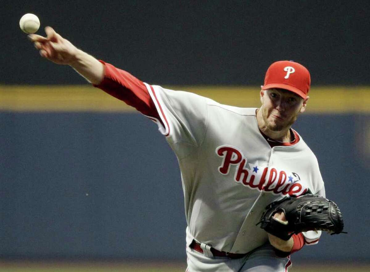 FILE PHOTO: MORRY GASH: ASSOCIATED PRESS: Philadelphia's Roy Halladay was his usual dominant self, stymieing the Brewers over eight innings in Friday's win. Federal aviation investigators say retired star pitcher Roy Halladay performed steep turns and flew feet above the water in his small plane moments before his fatal crash two weeks ago.