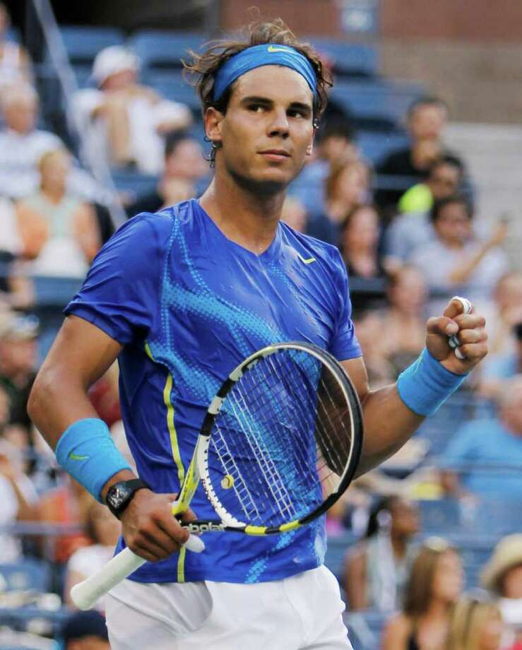 Rafael Nadal of Spain reacts after winning his quarterfinal match against Andy Roddick at the U.S. Open tennis tournament in New York, Friday, Sept. 9, 2011. (AP Photo/Mike Groll) Photo: Mike Groll