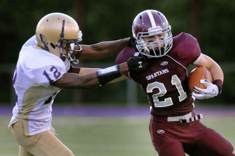 Burnt Hills Thomas Ruppel (21), right, gains yards as Amsterdam's Matthew White defends on Saturday, Sept. 9, 2011, at Lynch Middle School in Amsterdam, N.Y. (Cindy Schultz / Times Union) Photo: Cindy Schultz