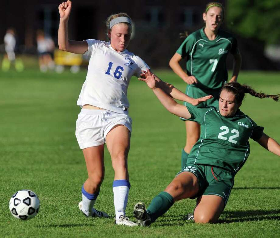 Shenendehowa's Erin Luibrand (22), right, kicks the ball away from Saratoga's Isabella Wager (16) during their soccer game on Saturday, Sept. 9, 2011, at Saratoga Springs High in Saratoga Springs, N.Y. (Cindy Schultz / Times Union) Photo: Cindy Schultz