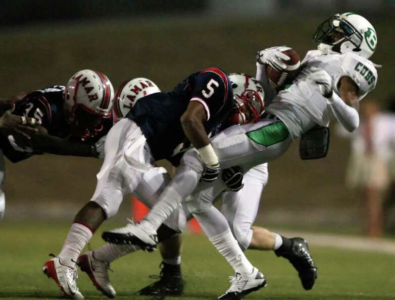 Brenham's Tre'mund Moore, right, is upended by Lamar's Daniel Lopez after making a reception during