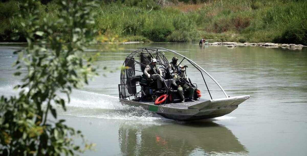 A Department of Homeland Security airboat carrying Border Patrol Agents patrol the Rio Grande near Laredo International Bridge I in Laredo, Texas, Thursday, September 8, 2011.