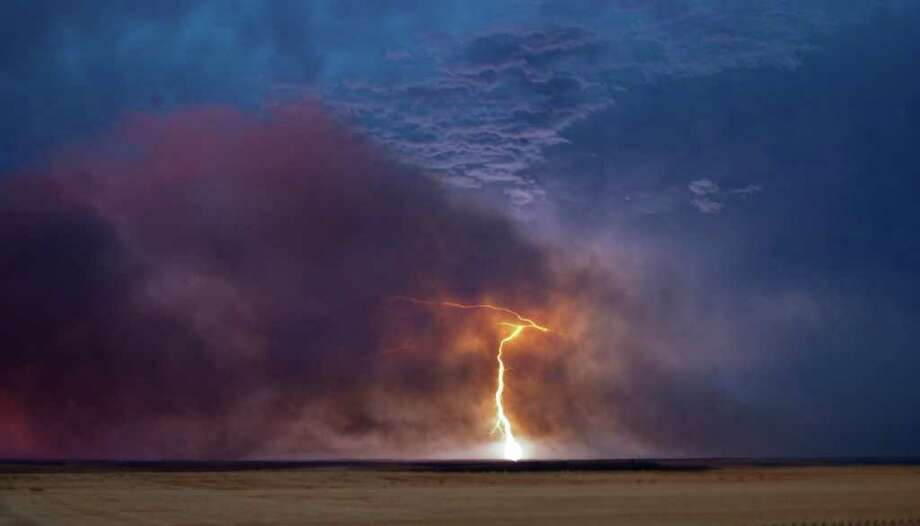 Lightening strikes near a burning wildfire near Pomeroy, Wash. Lightening strikes are believed to have started wildfires that have burned more than 5,000 acres of grassland in southeast Washington. Photo: Danny Goff, ASSOCIATED PRESS / AP2011