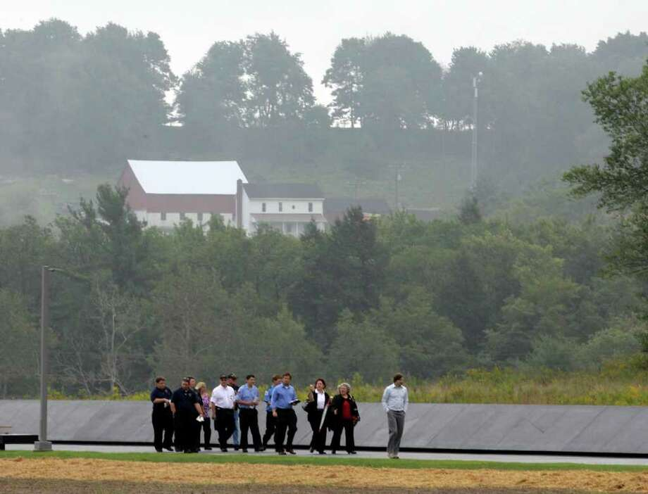 Family and other visitors walk near a section of phase I of the permanent Flight 93 National Memorial, scheduled to be dedicated Saturday afternoon,  near the crash site of United Flight 93 in Shanksville, Pa. Saturday Sept. 10, 2011.  (AP Photo/Amy Sancetta) Photo: Amy Sancetta / AP
