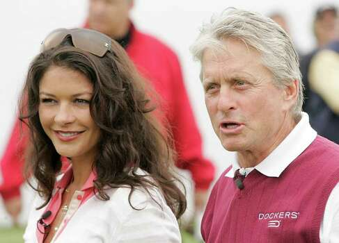 Actress Catherine Zeta Jones, left, and her husband, actor Michael Douglas, pose for a photo during the ninth annual Michael Douglas and Friends Celebrity Golf event in Rancho Palos Verdes, Calif., Sunday, April 29, 2007. The couple were seen having dinner at the Bedford Post in Bedford, N.Y. Saturday night. (AP Photo/Dan Steinberg) Photo: Dan Steinberg, AP / R-STEINBERG