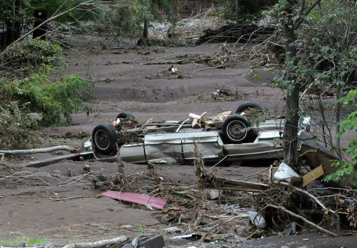 A washed up car lays in mud near the Schoharie Creek in Jewett Center, N.Y. on Sept. 8, 2011.