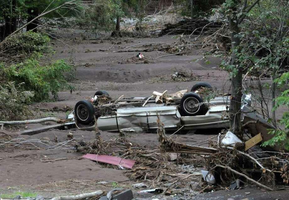 A washed up car lays in mud near the Schoharie Creek in Jewett Center, N.Y. on Sept. 8, 2011. Photo: Lori Van Buren, Lori Van Buren / Times Union