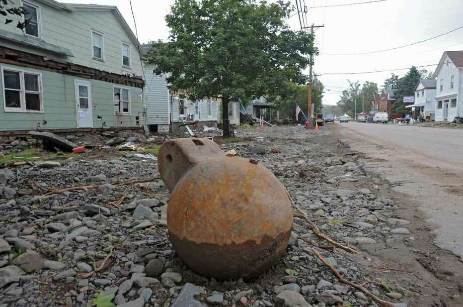 A wrecking ball was dropped off near damaged buildings on Main St. in Prattsville, N.Y. on Sept. 8, 2011. The Schoharie Creek flooded the town after tropical storm Irene. Photo: Lori Van Buren, Lori Van Buren / Times Union