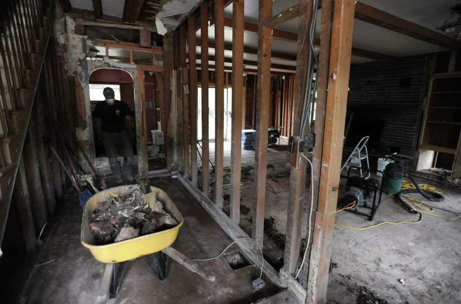 Steve Meyer of Minnesota helps clean up his mother-in-law's home on Main St. in Prattsville, N.Y. on Sept. 8, 2011. The Schoharie Creek flooded the town after tropical storm Irene. Photo: Lori Van Buren, Lori Van Buren / Times Union