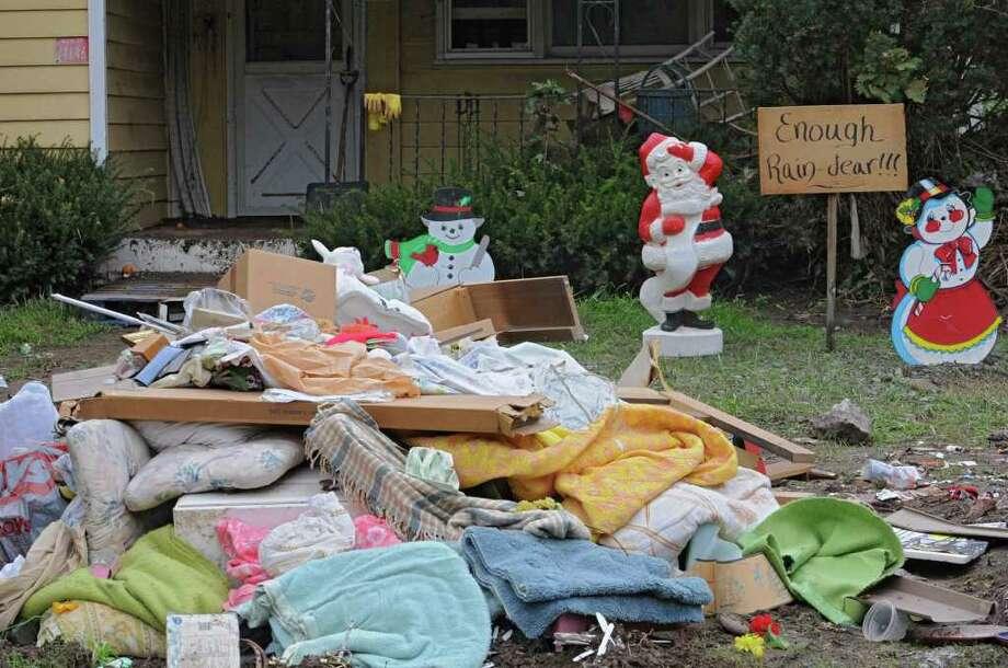 Damaged buildings and ruined belongings line Main St. in Prattsville, N.Y. on Sept. 8, 2011. The Schoharie Creek flooded the town after tropical storm Irene. Photo: Lori Van Buren, Lori Van Buren / Times Union