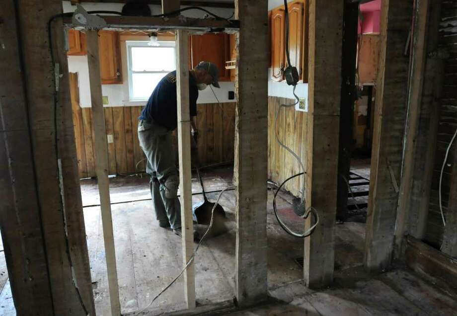 Steve Meyer of Minnesota helps clean up his mother-in-law's home on Main St. in Prattsville, N.Y. on Sept. 8, 2011. The Schoharie Creek flooded the town after tropical storm Irene. Photo: Lori Van Buren, Lori Van Buren / Times Union