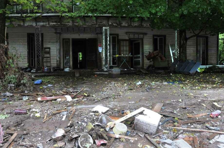 Damaged buildings line Main St. in Prattsville, N.Y. on Sept. 8, 2011. The Schoharie Creek flooded the town after tropical storm Irene. Photo: Lori Van Buren, Lori Van Buren / Times Union